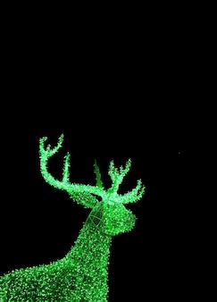 Vivid green illuminated christmas reindeer shaped outdoor decoration lights on dark background