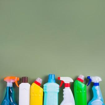 Vivid plastic bottles on green background