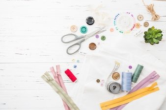 Vivid sewing items on wooden background