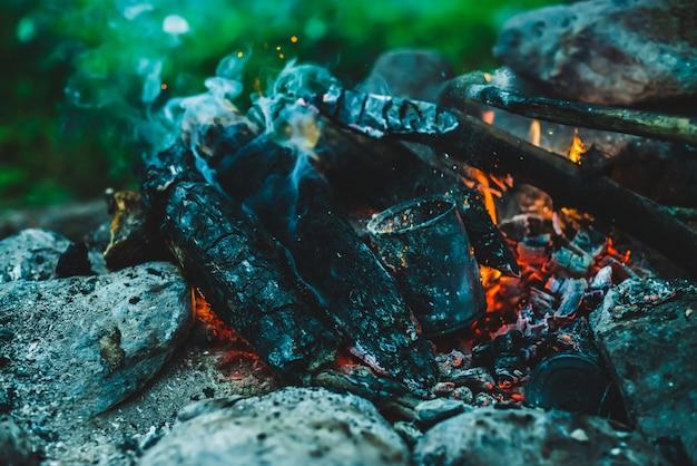 Vivid smoldered firewoods burned in fire closeup.