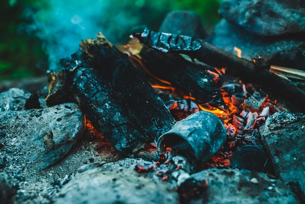 Vivid smoldered firewoods burned in fire