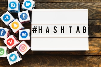 Vivid social networking icons blocks besides hashtag text