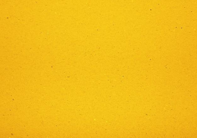 Vivid yellow design paper parchment background texture with dark nap fibers pattern