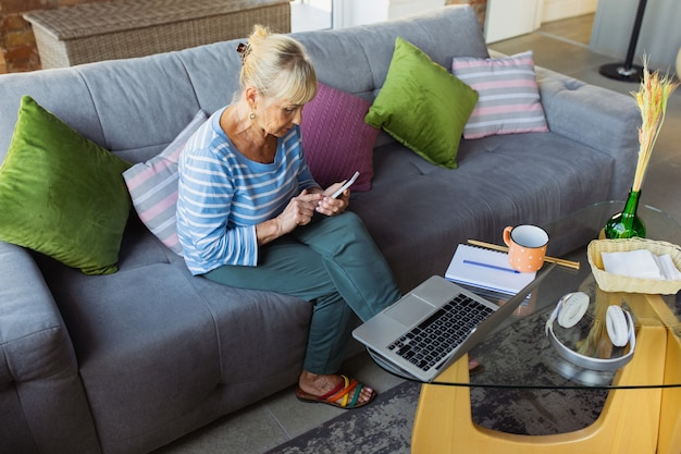 Vlog blog selfie senior woman studying at home getting online courses selfdevelopment