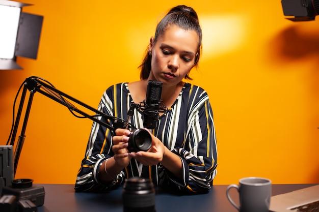 Vlogger recording test of lens focus for podcast