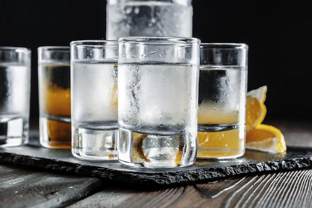 Vodka in  glasses on rustic wood