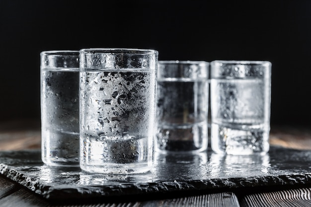 Vodka in  glasses on rustic wood