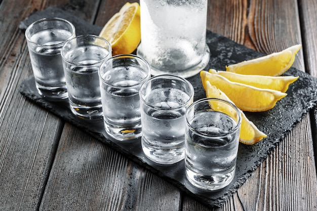 Vodka in shot glasses on rustic wood