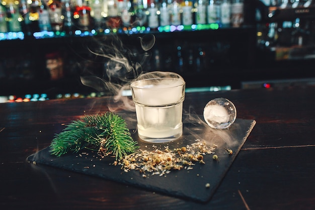 Vodka with smoke from liquid nitrogen.