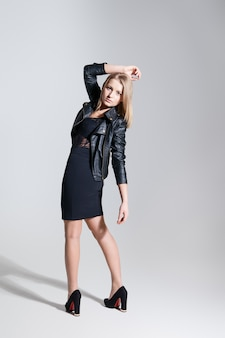 Vogue style. stylish woman fashion model  in trendy black clothes