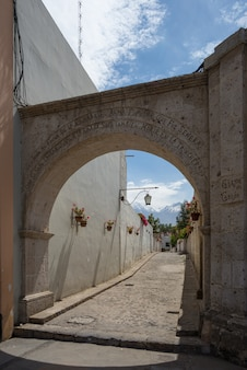 Volanic stone arch and alley in arequipa, peru