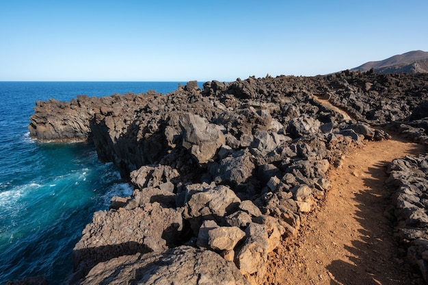 Volcanic coastline landscape. rocks and lava formations in canary islands, spain. high quality photo
