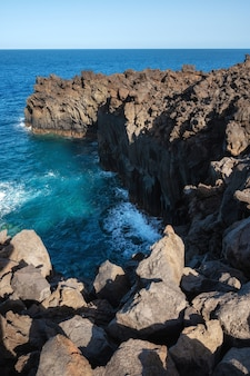 Volcanic coastline landscape. rocks and lava formations in canary islands, spain.