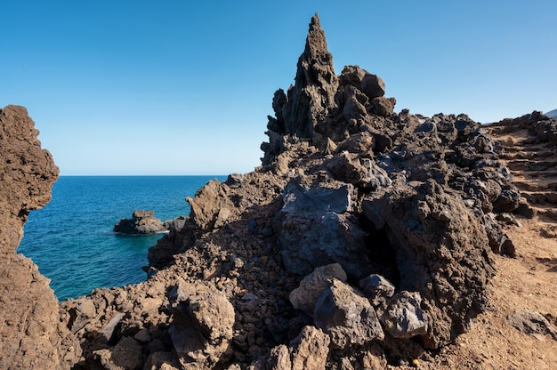 Volcanic coastline landscape. rocks and lava formations in el hierro, canary islands, spain. high quality photo