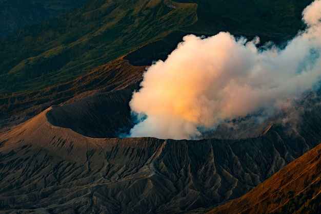 Volcano eruption with the sun shining down on the mountain in morning, bromo volcano,java,