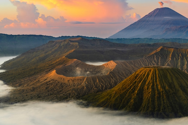 Volcano at sunrise with mist
