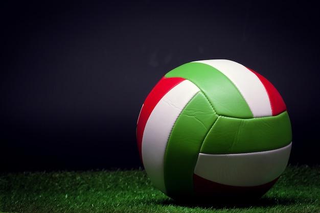 Volleyball ball on grass