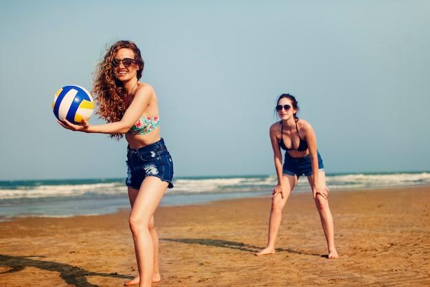 Volleyball beach women summer playful friends concept