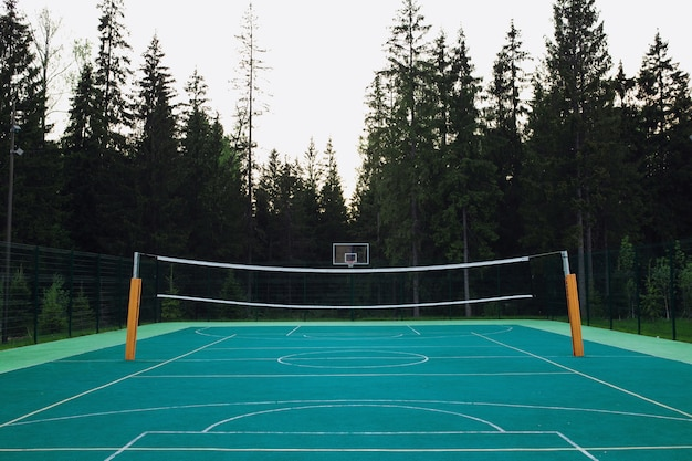 Volleyball court in the forest in the evening
