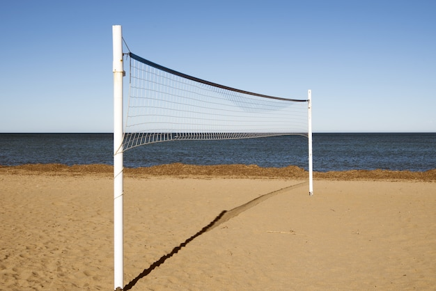 Volleyball net in the sandy beach during the daytime