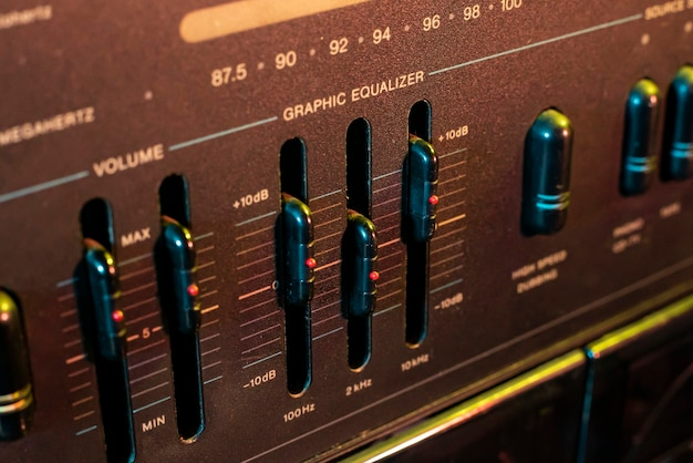 Volume and equalizer controller detail in an old stereo equipment