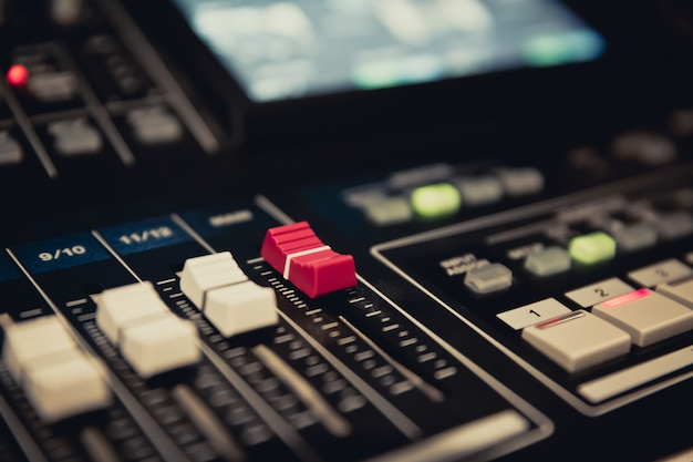 Volume slide control on professional sound mixer.