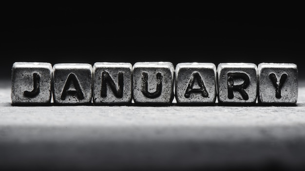 Volumetric inscription january silver metal cubes on a dark black background. deadline calendar, personal scheduling and time management