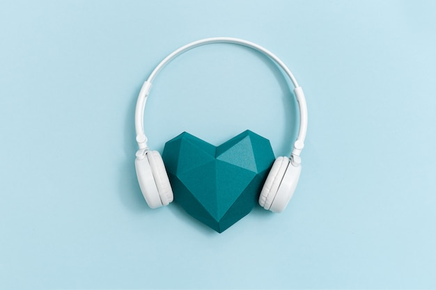 Volumetric paper heart in white headphones.