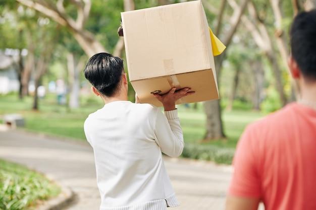 Volunteer carrying box of garbage