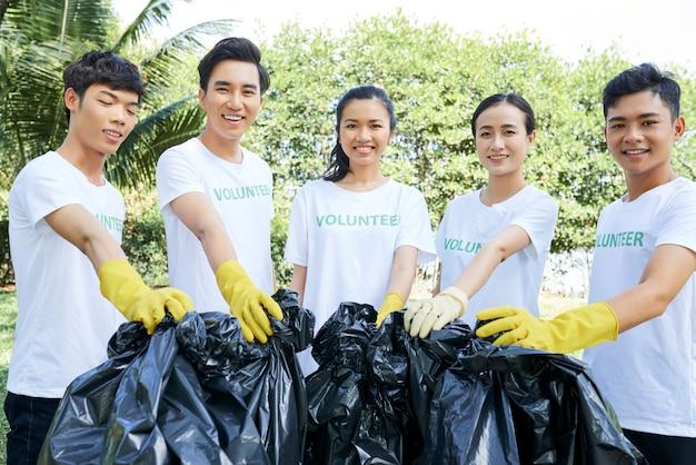 Volunteer group with garbage bags