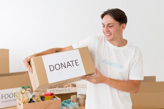 Volunteer holding a donate box