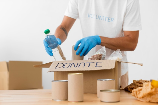 Volunteer placing different goodies in donation boxes