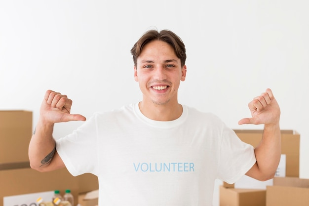 Volunteer pointing to his t-shirt