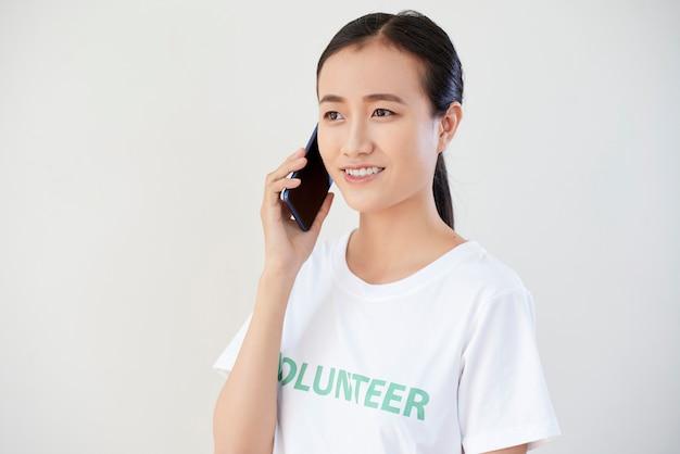 Volunteer talking on mobile phone