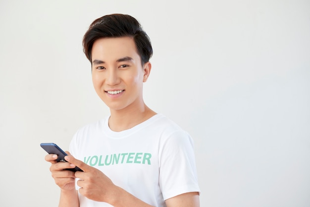 Volunteer typing a message on phone