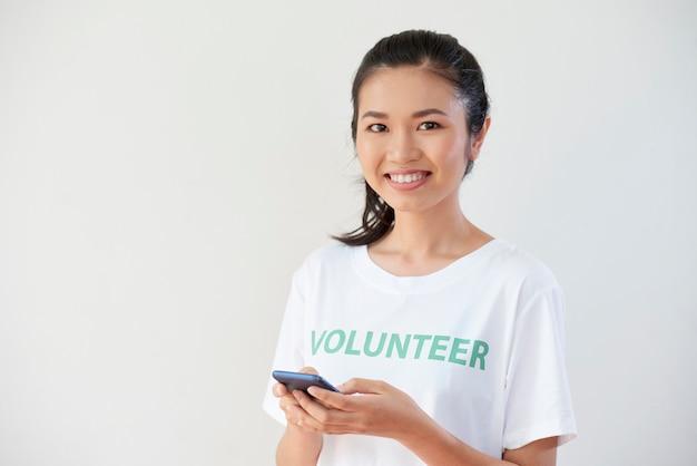 Volunteer using mobile phone in work