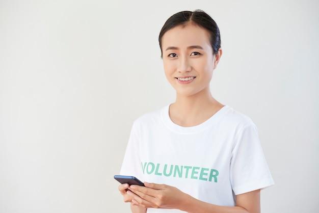 Volunteer using mobile phone