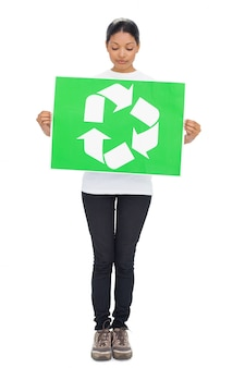 Volunteer young woman holding recycling sign