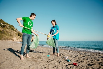 Volunteers collecting rubbish at the beach