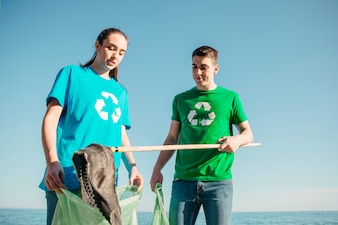 Volunteers collecting trash at the beach