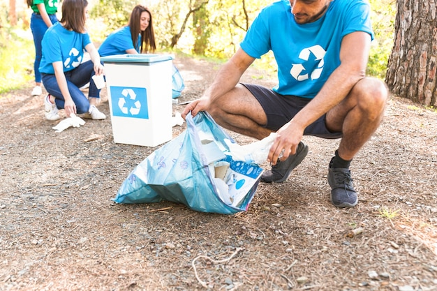 Volunteers collecting trash in forest