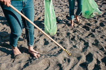 Volunteers collecting waste on the sand
