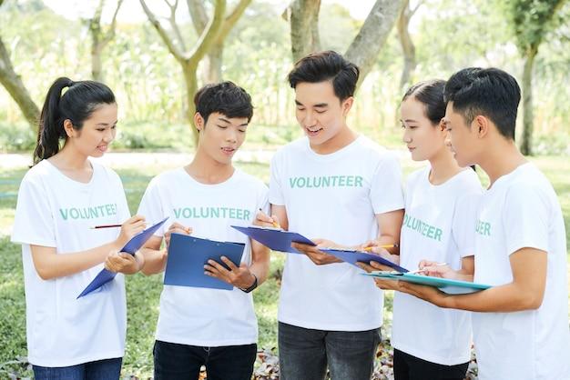 Volunteers distributing their work