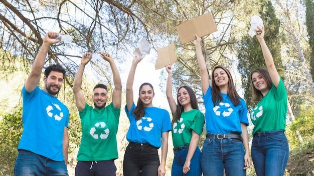 Volunteers holding trash in park