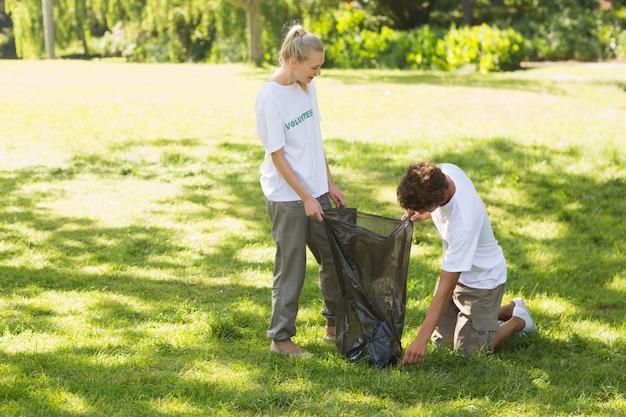 Volunteers picking up litter in park