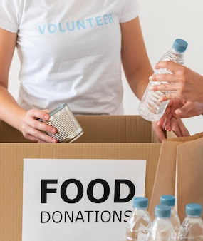 Volunteers with box and water for donation