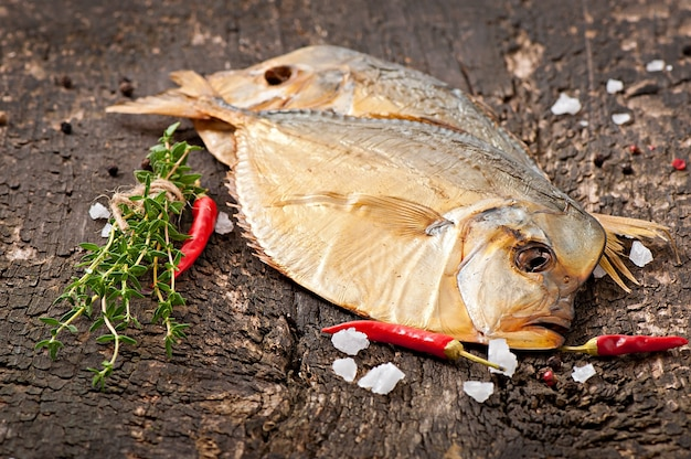 Vomer smoked fish on the wooden surface