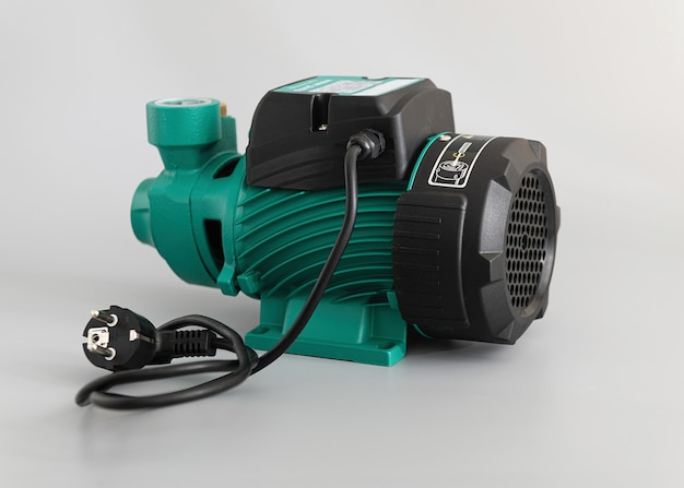 Vortex self-priming pump, side view, on a light gray background