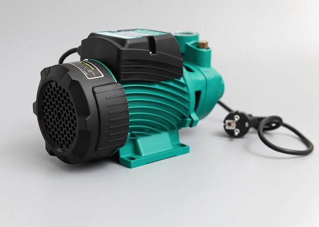 Vortex self-priming pump, side view, on a light gray wall
