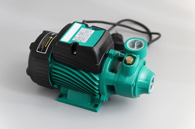 Vortex self-priming pump, top-side view, on a light gray background Premium Photo